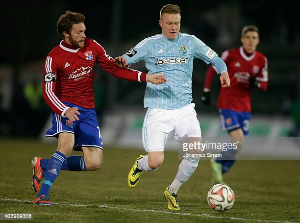 Yannic Thiel of Unterhaching and Nicolai Lorenzoni of Chemnitz fight for the ball during the Third League match between SpVgg Unterhaching and...