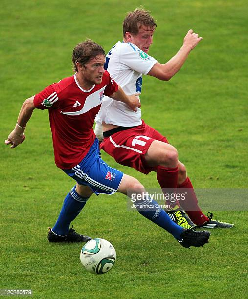 Yannic Thiel of Unterhaching battles for the ball with Richard Weil of Heidenheim during the Third League match between SpVgg Unterhaching and 1. FC...