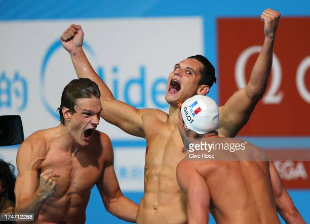 Yannick Agnel Florent Manaudou and Fabien Gilot of France celebrate after the Swimming Men's 4x100m Freestyle on day nine of the 15th FINA World...