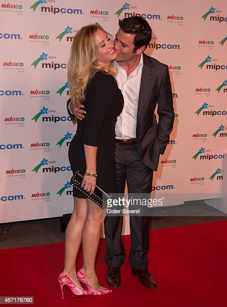 Yannick Bisson and Chantal Craig attend the opening red carpet party MIPCOM 2014 at Hotel Martinez on October 13 2014 in Cannes France