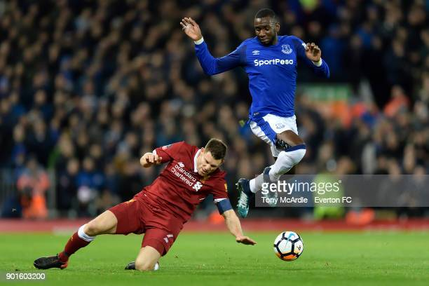 Yannick Bolasie evades the challenge of James Milner during The Emirates FA Cup Third Round match between Liverpool and Everton at the Anfield on...