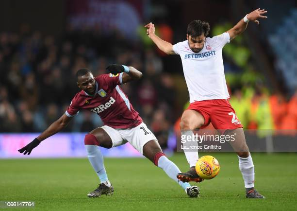 Yannick Bolasie of Aston Villa and Claudio Yacob of Notts Forest in action during the Sky Bet Championship match between Aston Villa and Nottingham...