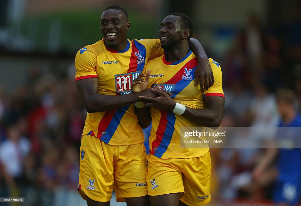 Yannick Bolasie of Crystal Palace celebrates after scoring to make it 1-2 with Freddie Ladapo during the Pre-Season Friendly match between AFC Wimbledon and Crystal Palace at The Cherry Red Records Stadium on July 27, 2016 in Kingston upon Thames, England.