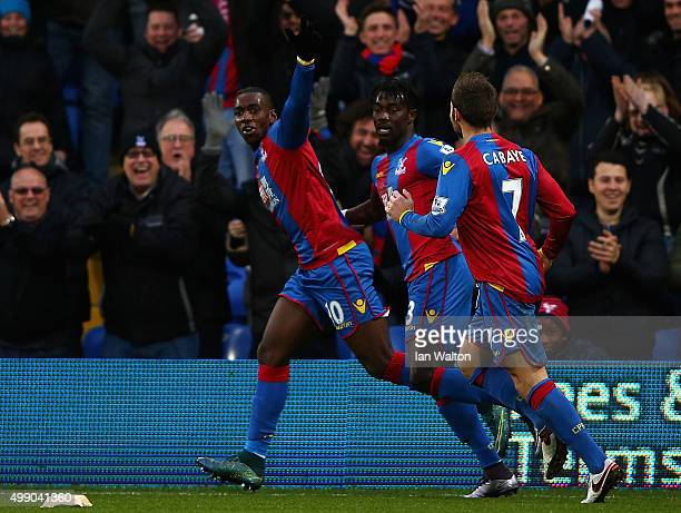 Yannick Bolasie of Crystal Palace celebrates scoring his team's second goal with his team mates during the Barclays Premier League match between...