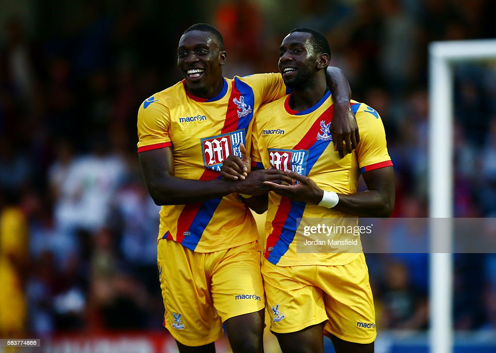 Yannick Bolasie of Crystal Palace celebrates with Freddie Ladapo of Crystal Palaces after he scores his sides second goal during the pre-season friendly between AFC Wimbledon and Crystal Palace at The Cherry Red Records Stadium on July 27, 2016 in Kingston upon Thames, England.