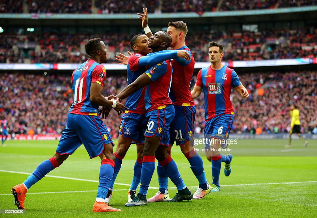 Yannick Bolasie of Crystal Palace (10) celebrates with team mates as he score their first goal during The Emirates FA Cup semi final match between Watford and Crystal Palace at Wembley Stadium on April 24, 2016 in London, England.