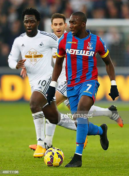 Yannick Bolasie of Crystal Palace is chased by Wilfried Bony of Swansea City during the Barclays Premier League match between Swansea City and...