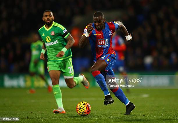 Yannick Bolasie of Crystal Palace is purseud by Yann M'Vila of Sunderland during the Barclays Premier League match between Crystal Palace and...