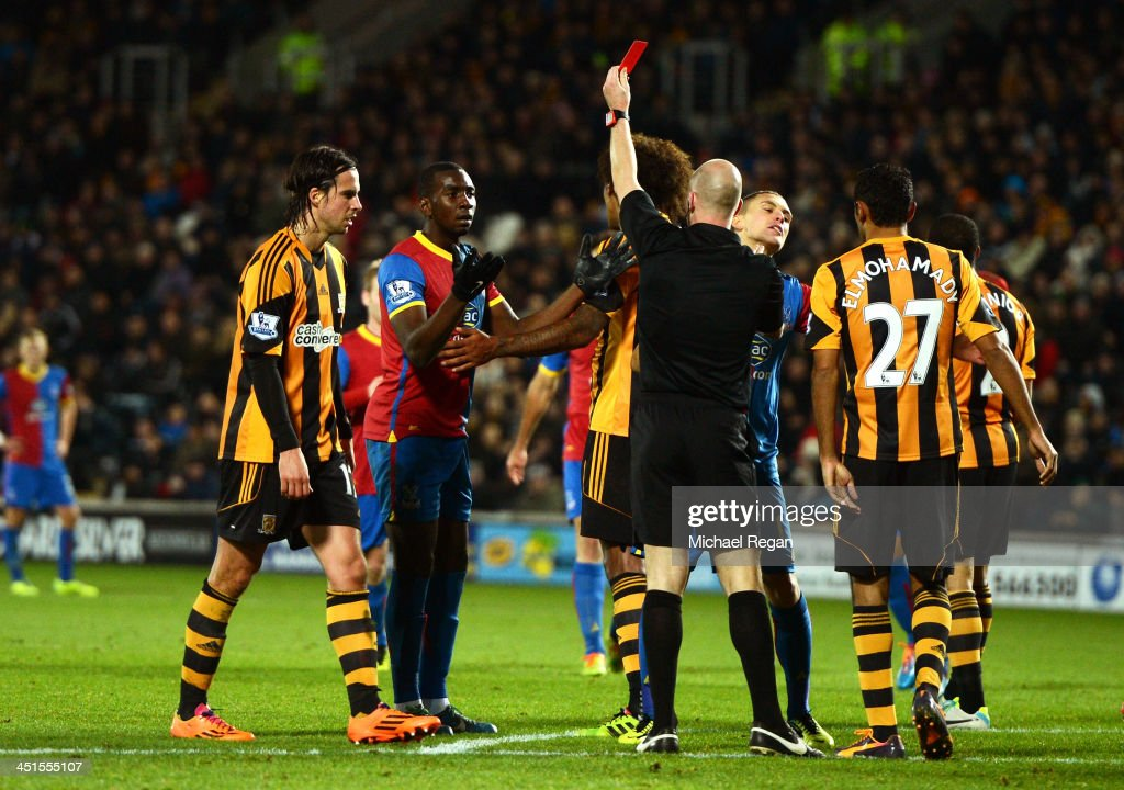 Yannick Bolasie of Crystal Palace is shown the red card by referee Anthony Taylor during the Barclays Premier League match between Hull City and Crystal Palace at KC Stadium on November 23, 2013 in Hull, England.