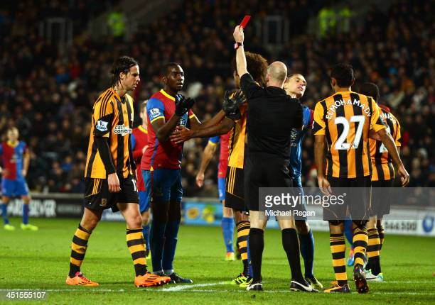 Yannick Bolasie of Crystal Palace is shown the red card by referee Anthony Taylor during the Barclays Premier League match between Hull City and...
