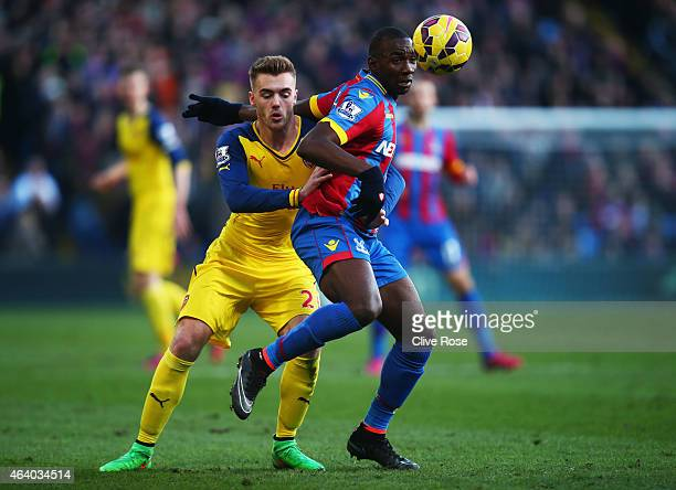 Yannick Bolasie of Crystal Palace takes on Calum Chambers of Arsenal during the Barclays Premier League match between Crystal Palace and Arsenal at...