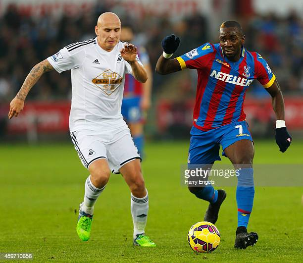 Yannick Bolasie of Crystal Palace takes on Jonjo Shelvey of Swansea City during the Barclays Premier League match between Swansea City and Crystal...