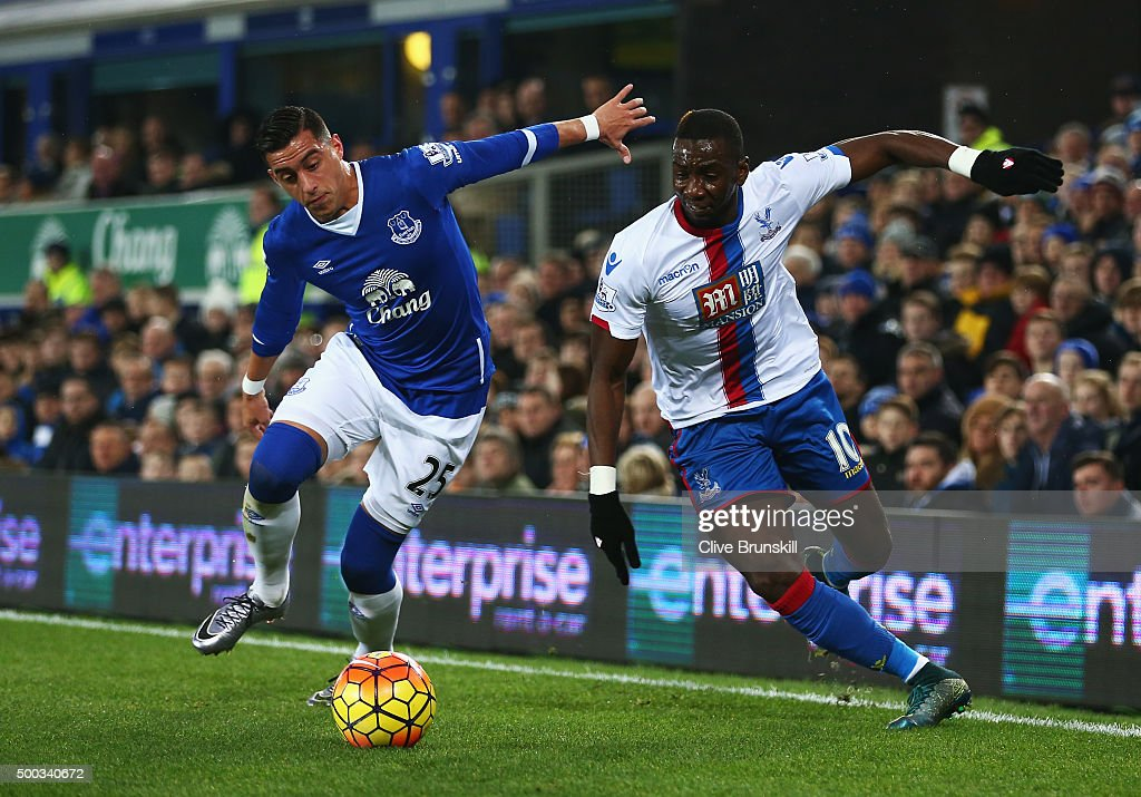 Yannick Bolasie of Crystal Palace takes on Ramiro Funes Mori of Everton during the Barclays Premier League match between Everton and Crystal Palace at Goodison Park on December 7, 2015 in Liverpool, England.