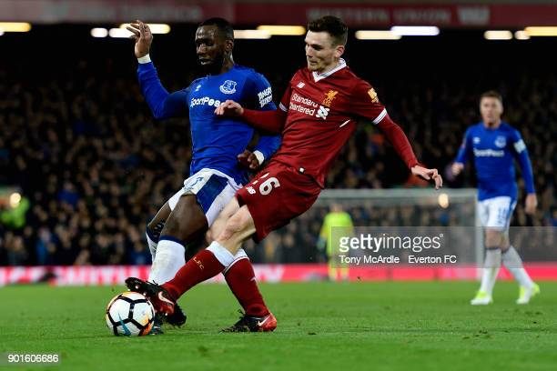 Yannick Bolasie of Everton and Andrew Robertson challenge for the ballduring The Emirates FA Cup Third Round match between Liverpool and Everton at...