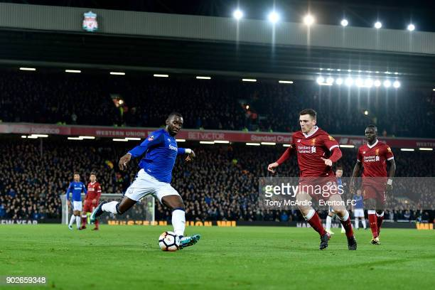 Yannick Bolasie of Everton and Andrew Robertson challenge for the ball during The Emirates FA Cup Third Round match between Liverpool and Everton at...