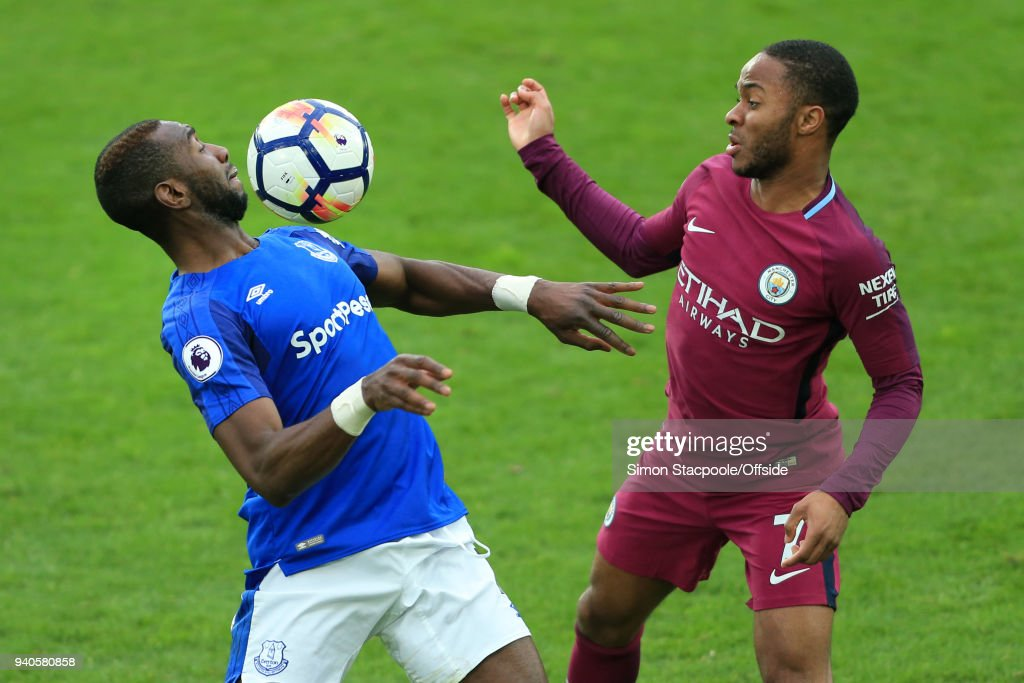 Yannick Bolasie of Everton battles with Raheem Sterling of Man City during the Premier League match between Everton and Manchester City at Goodison Park on March 31, 2018 in Liverpool, England.