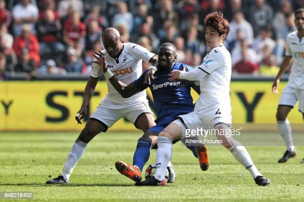 Yannick Bolasie of Everton challenged by Andre Ayew and Ki SungYueng of Swansea City during the Premier League match between Swansea City and Everton...