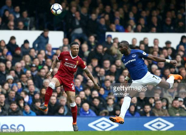 Yannick Bolasie of Everton heads the ball away from Nathaniel Clyne of Liverpool during the Premier League match between Everton and Liverpool at...
