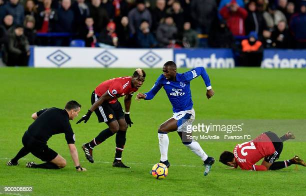 Yannick Bolasie of Everton on the ball as referee Andre Marriner takes a tumble during the Premier League match between Everton and Manchester United...