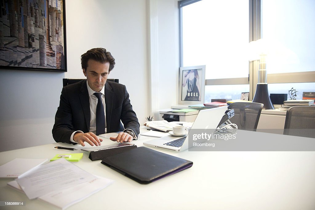 Yannick Bollore, director general and vice president of Havas SA, is seen working on an Apple Inc. iPad as he sits in his office at the company's headquarters in Paris, France, on Friday, Dec. 14, 2012. Havas SA, the French advertising company which is known for memorable advertising campaigns, including the 2009 commercials for Evian water that featured babies on roller skates. Photographer: Balint Porneczi/Bloomberg via Getty Images