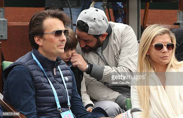 Yannick Bollore his wife Chloe Bollore above them Cyril Hanouna and his son attend the women's final on day 14 of the 2016 French Open held at...