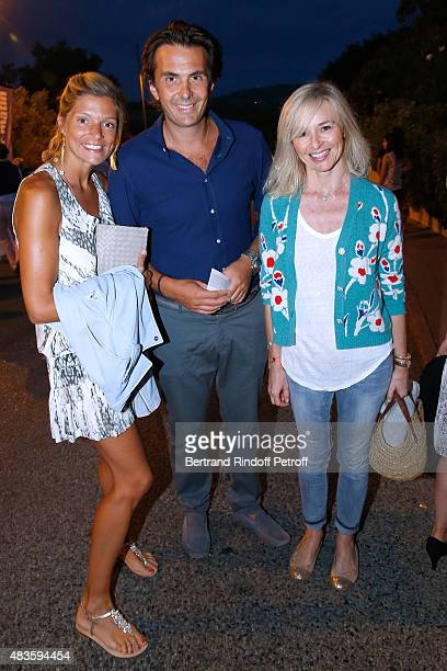 Yannick Bollore standing between his wife Chloe and actress Anais Jeanneret Vincent Bollore's wife attend the 'Fabrice Luchini Poesie ' show during...
