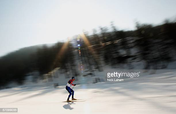 Yannick Bourseaux of France competes in the Men's 10 KM - Standing Cross Country during Day Five of the Turin 2006 Winter Paralympic Games on March...