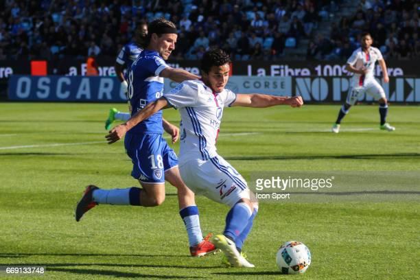 Yannick Cahuzac of Bastia and Rafael of Lyon during the Ligue 1 match between SC Bastia and Olympique Lyonnais Lyon at Stade Armand Cesari on April...