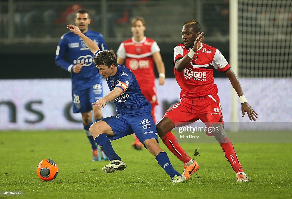 Yannick Cahuzac of Bastia and Tongo Doumbia of Valenciennes in action during the french Ligue 1 match between Valenciennes FC and SC Bastia at the Stade du Hainaut on January 11, 2014 in Valenciennes, France.