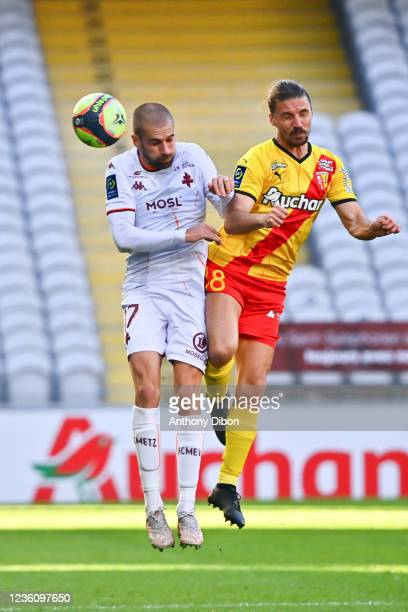 Yannick CAHUZAC of Rc Lens and Thomas DELAINE of Metz during the Ligue 1 Uber Eats match between Lens and Metz at Stade Bollaert-Delelis on October...