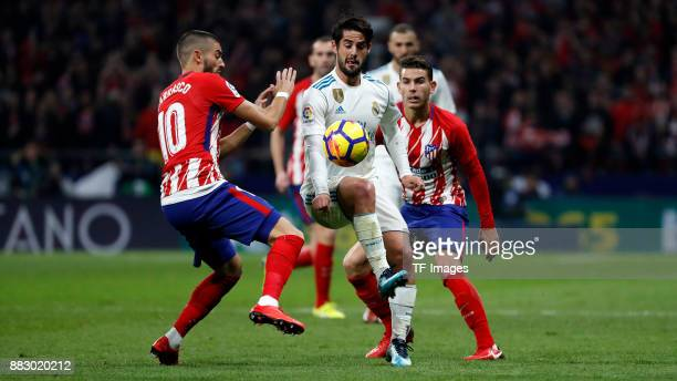 Yannick Carrasco of Atletico de Madrid and Isco Alarccon battle for the ball during a match between Atletico Madrid and Real Madrid as part of La...