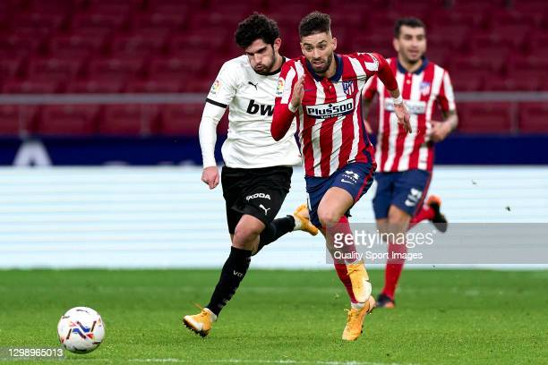Yannick Carrasco of Atletico de Madrid battle for the ball with Gonzalo Guedes of valencia CF during the La Liga Santader match between Atletico de...