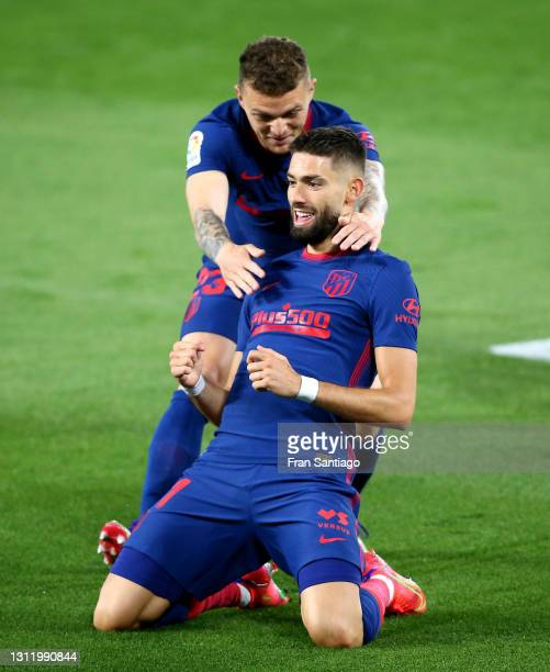 Yannick Carrasco of Atletico de Madrid celebrates with Kieran Trippier after scoring their side's first goal during the La Liga Santander match...