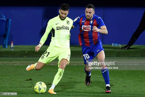 Yannick Carrasco of Atletico de Madrid is challenged by Edu Exposito of SD Eibar during the La Liga Santander match between SD Eibar and Atletico de...