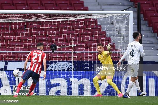 Yannick Carrasco of Atletico de Madrid scores their side's second goal past Alvaro Fernandez of SD Huesca during the La Liga Santander match between...