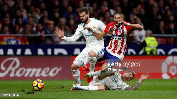 Yannick Carrasco of Atletico de Madrid Toni Kroos of Real Madrid and Nacho Fern·ndez of Real Madrid battle for the ball during a match between...