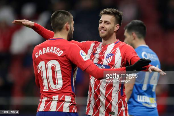 Yannick Carrasco of Atletico Madrid celebrates 10 with Sergio Gonzalez Teston of Atletico Madrid during the Spanish Copa del Rey match between...