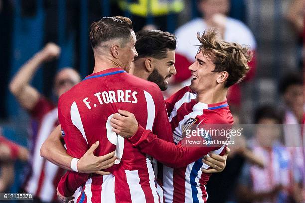 Yannick Carrasco of Atletico Madrid celebrates with teammates Fernando Torres and Antoine Griezmann during their 201617 UEFA Champions League match...