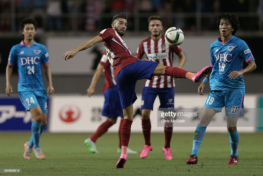 Yannick Carrasco #21 of Atletico Madrid deflects a pass against Sagan Tosu F.C. during the friendly match between Atletico Madrid and Sagan Tosu F.C. at Tosu Stadium on August 1, 2015 in Tosu, Japan.