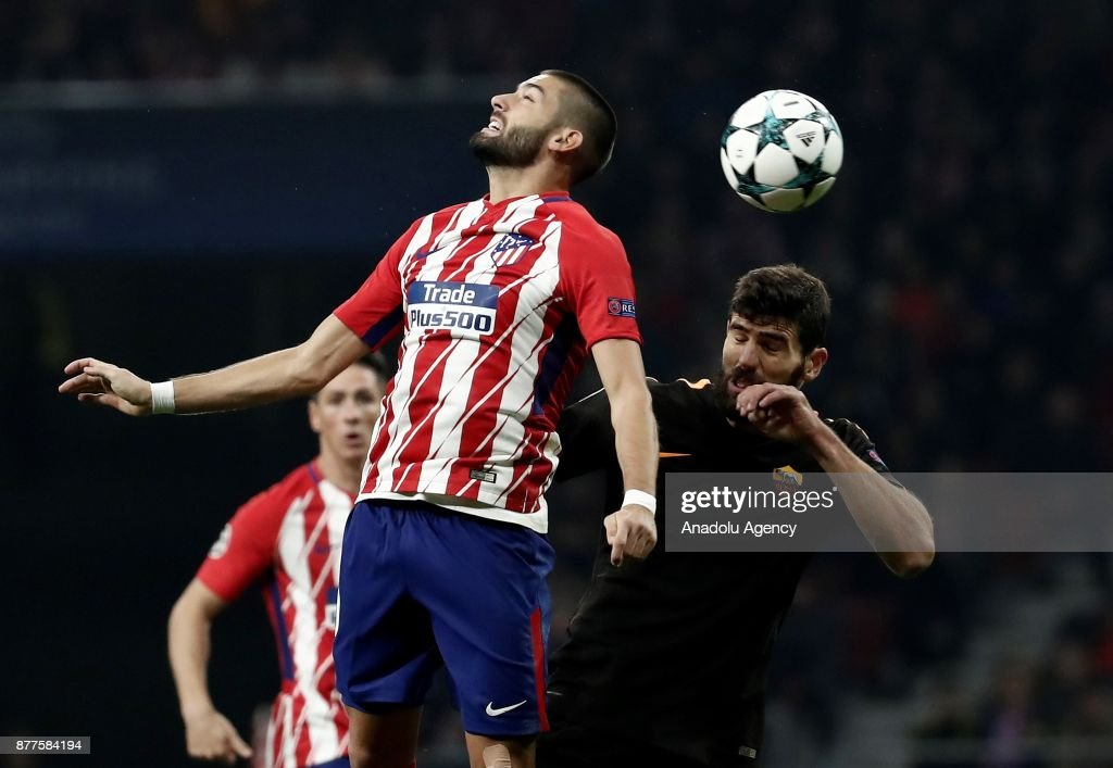 Yannick Carrasco (L) of Atletico Madrid in action against Federico Fazio (R) of AS Roma during UEFA Champions League Group C soccer match between Atletico Madrid and AS Roma at Wanda Metropolitano Stadium in Madrid, Spain on November 22, 2017.