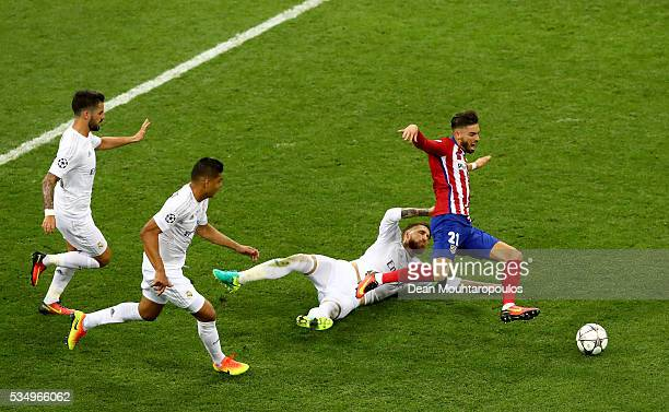 Yannick Carrasco of Atletico Madrid is fouled by Sergio Ramos of Real Madrid during the UEFA Champions League Final match between Real Madrid and...