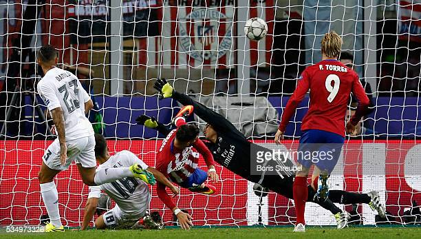 Yannick Carrasco of Atletico Madrid scores the equalizing goal during the Champions League final match between Real Madrid and Club Atletico de...