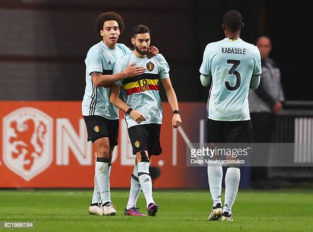 Yannick Carrasco of Belgium celebrates with Axel Witsel and Christian Kabasele as he scores their first and equalising goal during the international...