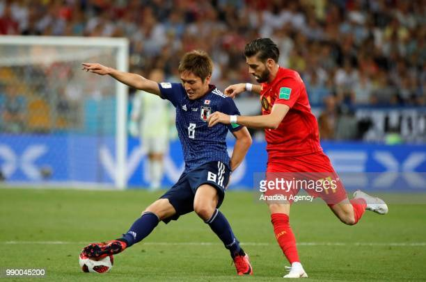 Yannick Carrasco of Belgium in action against Genki Haraguchi of Japan during the 2018 FIFA World Cup Russia Round of 16 match between Belgium and...