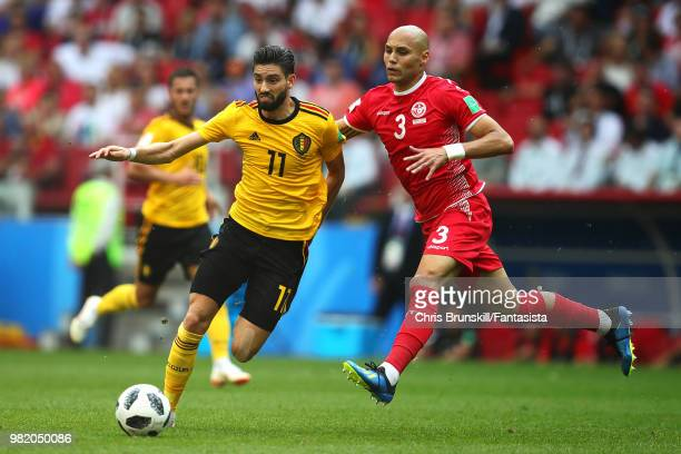 Yannick Carrasco of Belgium in action with Yohan Ben Alouane of Tunisia during the 2018 FIFA World Cup Russia group G match between Belgium and...