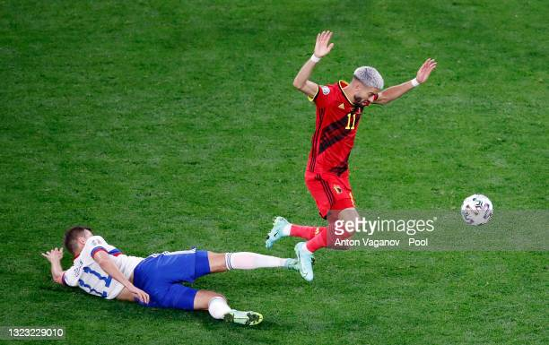 Yannick Carrasco of Belgium is challenged by Roman Zobnin of Russia during the UEFA Euro 2020 Championship Group B match between Belgium and Russia...