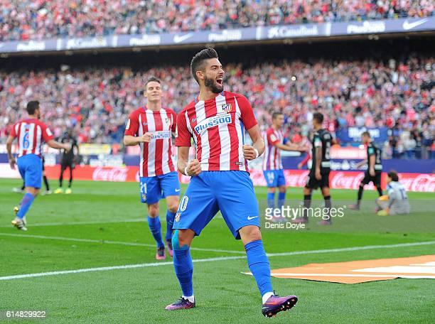 Yannick Carrasco of Club Atletico de Madrid celebrates after scoring his team's opning goal during the La Liga match between Club Atletico de Madrid...