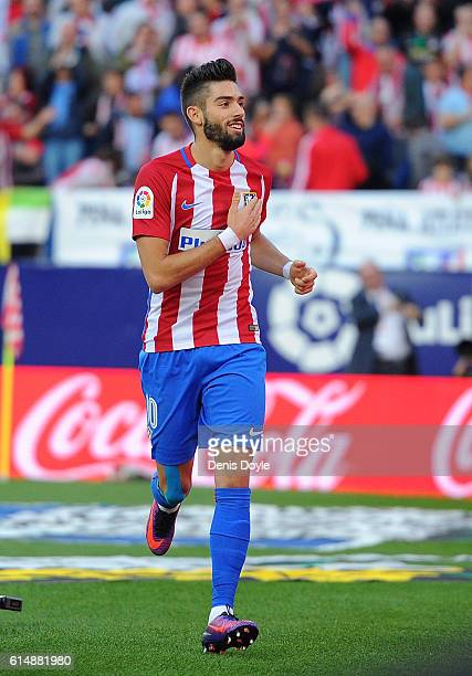 Yannick Carrasco of Club Atletico de Madrid celebrates after scoring his team's 2nd goal during the La Liga match between Club Atletico de Madrid and...