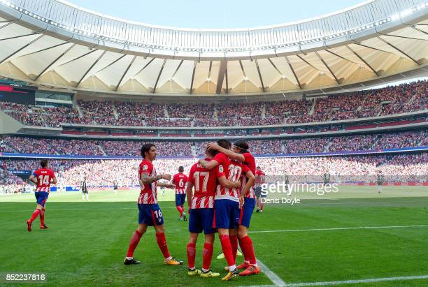 Yannick Carrasco of Club Atletico de Madrid celebrates after scoring his team's opening goal during the La Liga match between Atletico Madrid and...