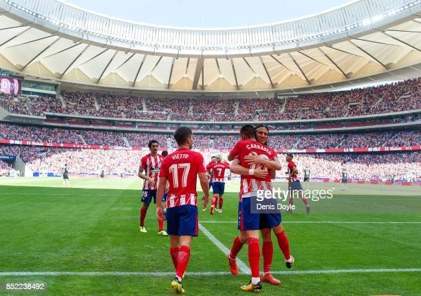 Yannick Carrasco of Club Atletico de Madrid celebrates with Felipe Luis after scoring his team's opening goal during the La Liga match between...
